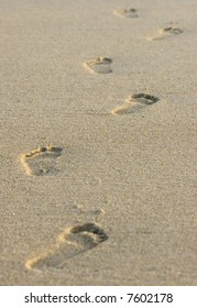 Footprints in the sand with shallow depth of field