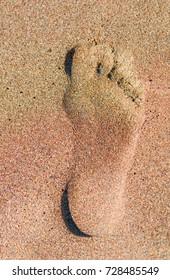 Footprints in the sand at sunset , iztuzu beach
