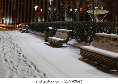 Footprints in the snow, winter park, Empty winter street, silence after a snowstorm, benches under the snow in Russia, permafrost, loneliness, the northern city, Moscow