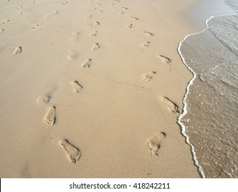 Footprints walking together on a beach