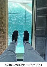 Foots on the glass tray inside the Akashi-Kaikyo Bridge - The longest suspension bridges in the world - Kobe, Japan