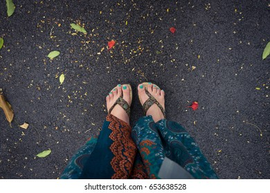 Foots of traveler on the road