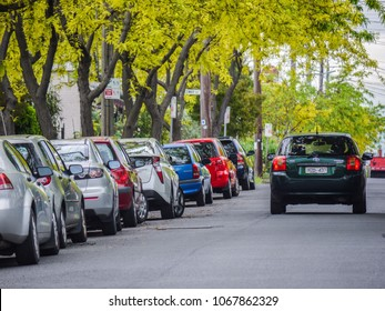 Footscray, VIC/Australia-Oct 19th 2017: car running on Melbourne's suburban street with family cars parked along the road.