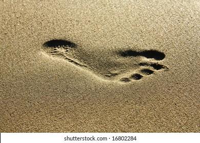 Footstep in golden sand...