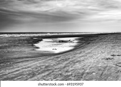"""""""Footsteps and Bicycle Tracks"""" Dusk at low tide on South Forest Beach, Hilton Head Island, SC."""