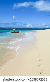 Footsteps to Island Tour Boat, on White Sand Beach - Daku, Siargao, Philippines
