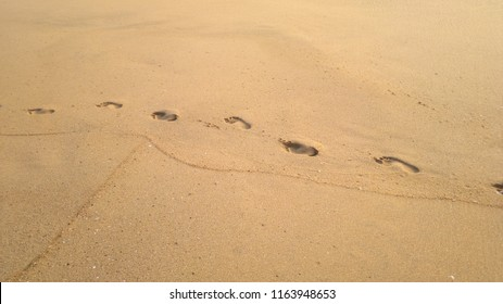 Footsteps on Sand at a Kerala Sea Beach