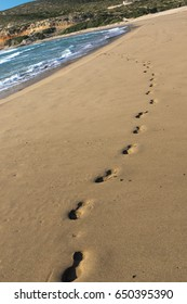 Footsteps on the seashore, windy weather