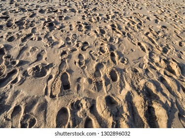 Footsteps in the sand on a winters day