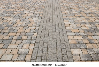 Footway street pavement background with colorful combined paving