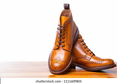 Footwear Concepts.Closeup of Pair of High Men's Tanned Brogues Boots. Isolated Over White Background.Horizontal Image