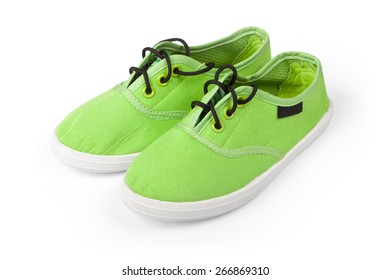 Footwear. Pair of green shoes isolated on white