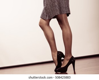 Footwear, part of body concept. Amazing legs with high heels. Woman wearing beautiful dress.