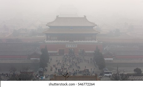 The Forbidden City shrouded by heavy smog. Beijing, China. Chinese characters on the door mean (translation) The Gate of Divine Might or Gate of Divine Prowess