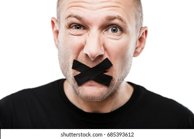 Forbidden word or speech censorship concept - scared adult man adhesive tape closed mouth white isolated