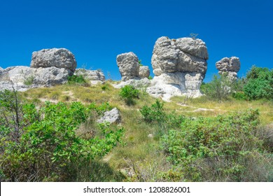 Forcalquier mushroom-shaped rock formations in Les Mourres nature park in France during a sunny day
