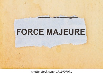 Force Majeure newspaper cut out with a vintage paper background
