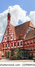 FORCHHEIM, GERMANY - JUNE 18 2014:Historical City Hall of Forchheim in german Oberfranken, Bavaria. Picturesque Half Timbered Building with little bell tower. Cloudy sky