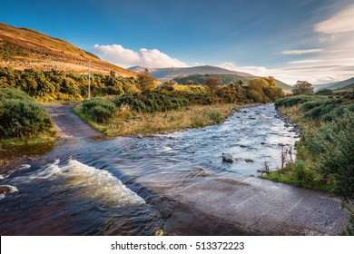 Ford on College Burn and The Cheviot / The Cheviot, from which the range takes its name, is the highest point in Northumberland, on the Anglo-Scottish borders, seen here in autumn from College Valley