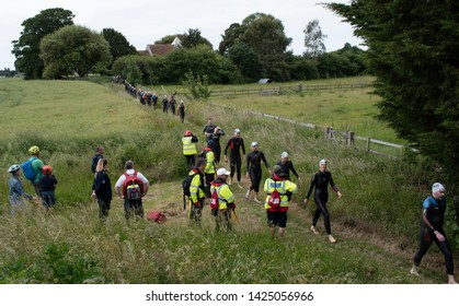 Ford, West Sussex, UK, June 15 2019, River Arun swim over the classic Ironman distance of 3.8km from Ford to Littlehampton. Walking to the start.