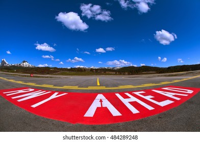 FORDE BRINGELAND, NORWAY - JUNE 2012 The warning sign painted on the taxiway warning that entry of the active runway is about to happen. Do not taxi beyond this sign without clearance.