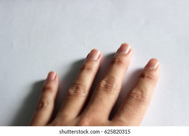 Fore fingers. Nail. White background. Closeup. Asian skin