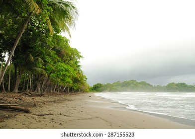A foreboding sky at the surfing beach of Playa Dominicalito in Costa Rica