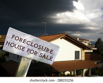 Foreclosure - home for sale real estate sign in front of house