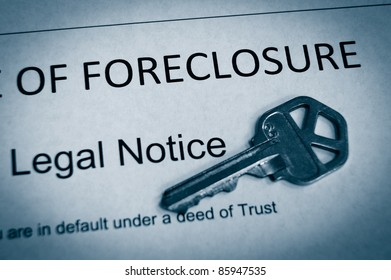 Foreclosure legal notice and house key macro in duotone