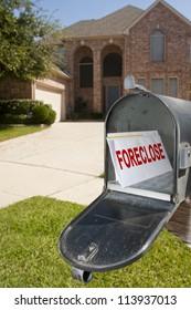 Foreclosure notice inside mailbox