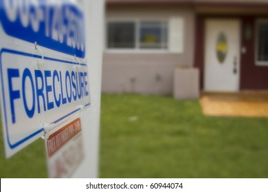 A foreclosure sign outside of a condemned home