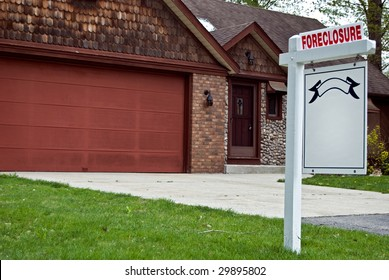 foreclosure sign in yard in the suburbs