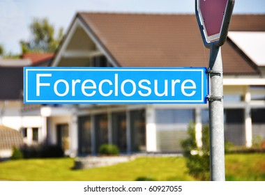 Foreclousure street sign against house