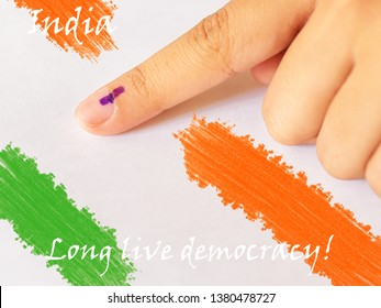 Forefinger marked with electoral ink against white background with Indian flag colors. Parliamentary (Lok Sabha) Elections 2019, India. Long live democracy.