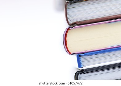 forefront of a group of books stacked