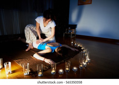 In the foreground candles, in the background the massage. Hardwood floors. state of relaxation