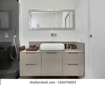 the foreground the counter top washbsin  on the wooden sink cabinet in the modern bathroom