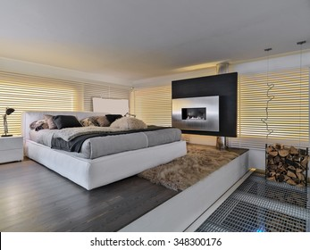 foreground of a modern bedroom with a fireplace Bioethanol