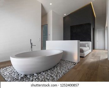 in the foreground the modern free-standing bathtub on small white stones in the bedroom the floor is made of wood