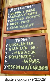 foreground of a  poster of the menu in a typical Spanish restaurant, Sevilla, Andalusia, Spain