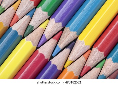 foreground of some crayons interleaved on a diagonal composition
