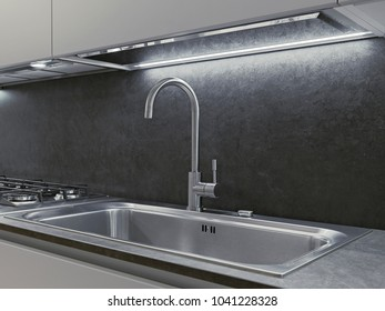 in the foreground the steel tap and steel sink  in the modern kitchen