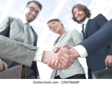 in the foreground.handshake of business partners