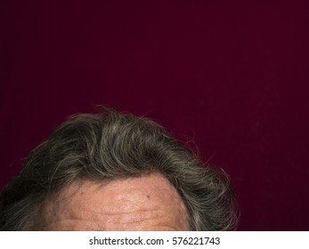 forehead Of middle aged caucasian Man on red background