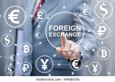 Foreign exchange financial business concept. Businessman touched external currency word icon on virtual screen. Finance trade and stock market technology