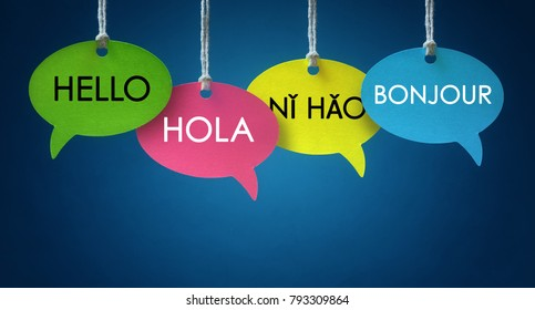 Foreign language colorful communication speech bubbles hanging from a cord over blue background