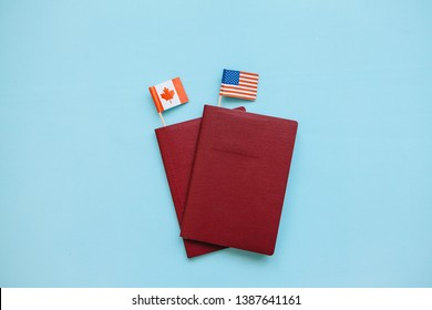 Foreign passport with the flags of the USA and Canada on a blue background. The concept of migration, work and travel.