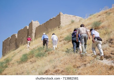 Foreigners walking to an old fortress in the capital of Afghanistan Kabul built on a hill
