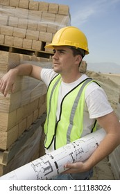 Foreman with blueprint at construction site