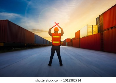 Foreman control  cargo train by light baton  in the container yard port international concept stop fee or free fee.